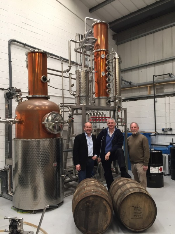 Robert Wicks of Westerham Brewery with Andy Reason and Norman Lewis of Anno Distillers with some of the bourbon barrels